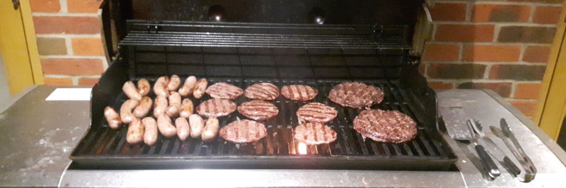 Gourmet  beef burgerds on a barbecue, handmade by our butcher for a private event in Dorchester, Dorset